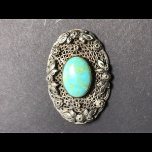Old tur and silver brooch